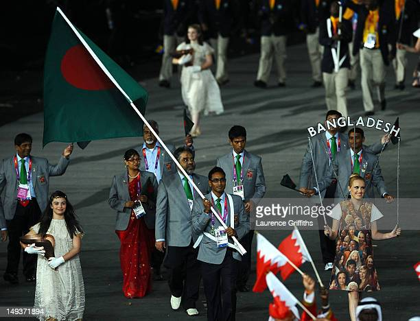 Rahman MD Mahfizur of the Bangladesh Olympic swimming team carries his country's flag during the Opening Ceremony of the London 2012 Olympic Games at...