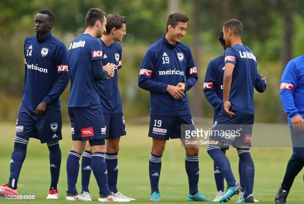 Rahmat Akbari of the Victory talks to his teammates during a Melbourne Victory ALeague training session at Gosch's Paddock on October 31 2018 in...