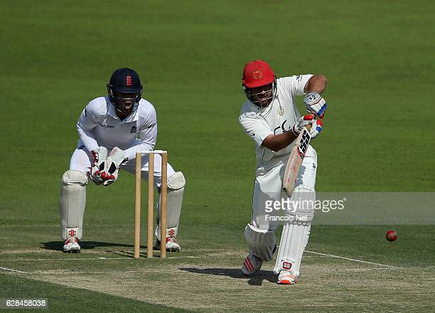 Rahmat Shah of Afghanistan bats during day two of the tour match between England Lions and Afghanistan at Zayed Cricket Stadium on December 8 2016 in...