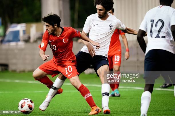 Rahmetullah Berisbek of Turkey and Yacine Adli of France vie for the ball during the football 2018 UEFA European Under19 Championship Group stage...
