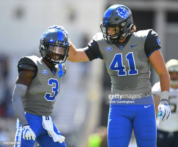 T J Rahming of the Duke Blue Devils is congratulated by Xander Gagnon after a special team play against the Georgia Tech Yellow Jackets on October 13...
