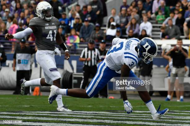 Rahming of the Duke Blue Devils scores a touchdown against the Northwestern Wildcats during the first half on September 8, 2018 at Ryan Field in...