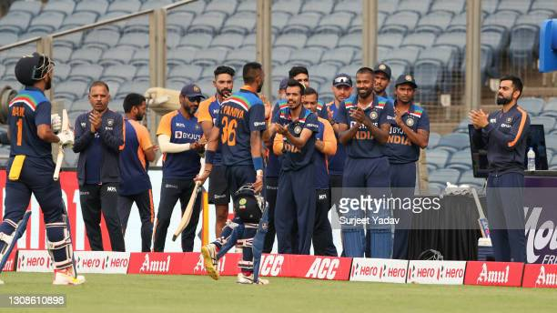 Rahul and Krunal Pandya of India are applauded from the field during 1st One Day International between India and England at MCA Stadium on March 23,...