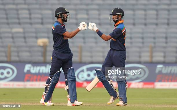 Rahul and Krunal Pandya of India touch gloves during 1st One Day International between India and England at MCA Stadium on March 23, 2021 in Pune,...