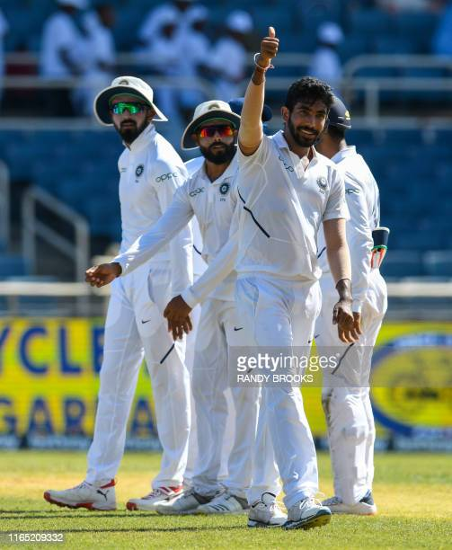 Rahul and Ravindra Jadeja watches as Jasprit Bumrah of India gives the hat-trick thumbs up during day 2 of the 2nd Test between West Indies and India...