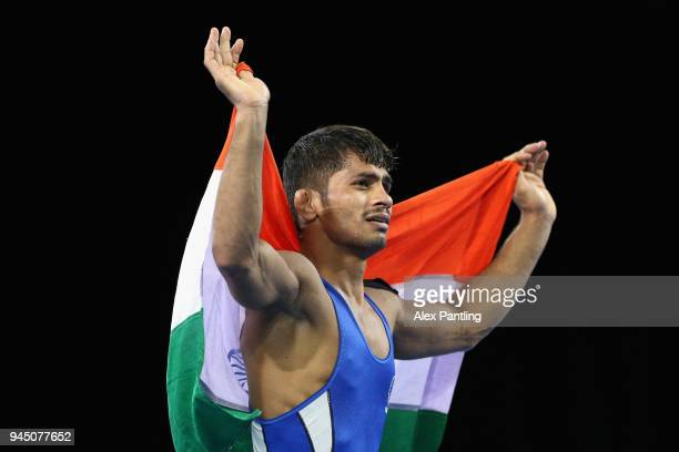 Rahul Aware of India celebrates winning the gold medal in the Men's Freestyle 57 kg final during Wrestling on day eight of the Gold Coast 2018...