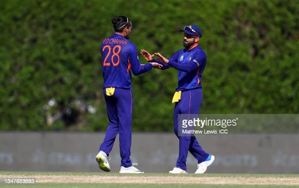 Rahul Chahar of India celebrates the wicket of Glenn Maxwell of Australia with team mate Virat Kohli during the India and Australia warm Up Match...