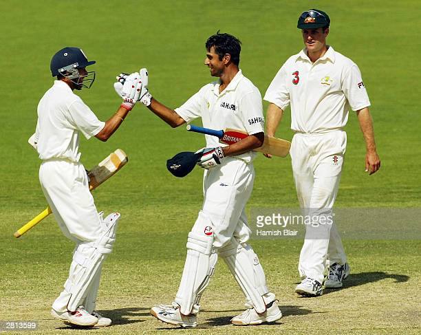 Rahul Dravid and Ajit Agarkar of India celebrate after the winning run during the fifth day of the 2nd Test between Australia and India at the...