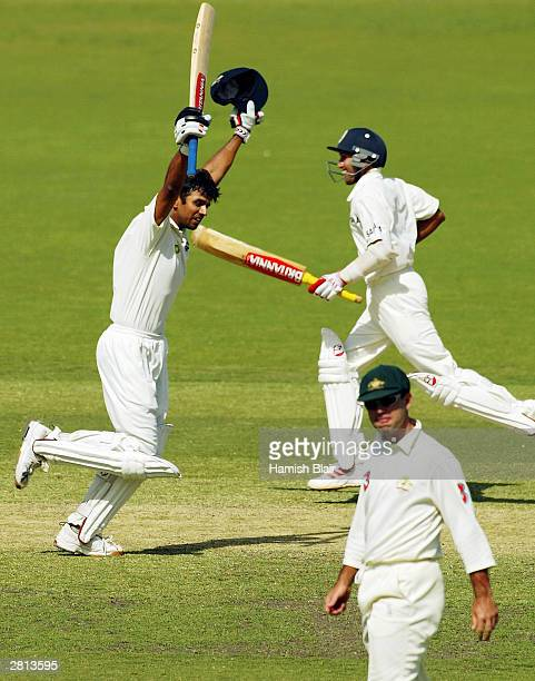 Rahul Dravid and Ajit Agarkar of India celebrate as they cross for the winning run during the fifth day of the 2nd Test between Australia and India...