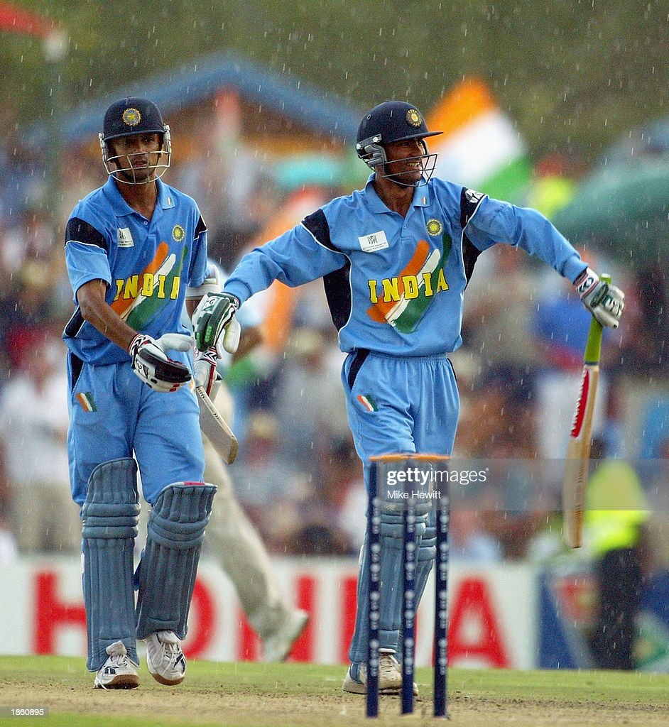 Rahul Dravid and Mohammad Kaif of India celebrate victory in the rain after the ICC Cricket World Cup Super Six match between New Zealand and India held on March 14, 2003 at Supersport Park in Centurion, South Africa. India won the match by 7 wickets.