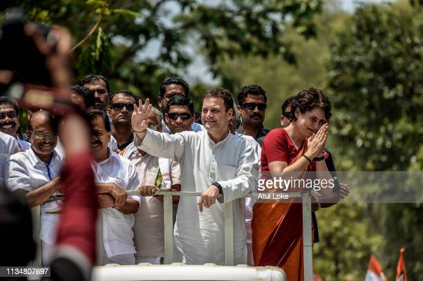 Rahul Gandhi and Priyanka Gandhi wave at the crowd in the road show after Rahul Gandhi filing nominations from Wayanad district on April 4, 2019 in...
