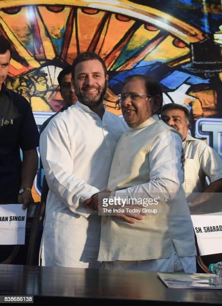 Rahul Gandhi former PM Manmohan Singh former JD president Sharad Yadav and CPI General Secretary Sitaram Yechuri during 'Sajha Virasat Bachao...