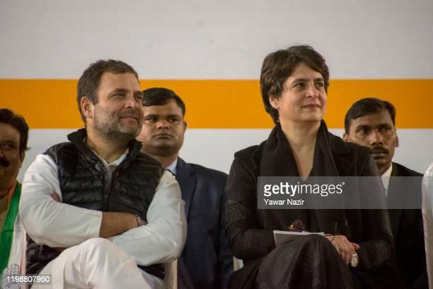 Rahul Gandhi, leader of Indian National Congress, speaks to his sister Priyanka Gandhi, general secretary of the Indian National Congress during...