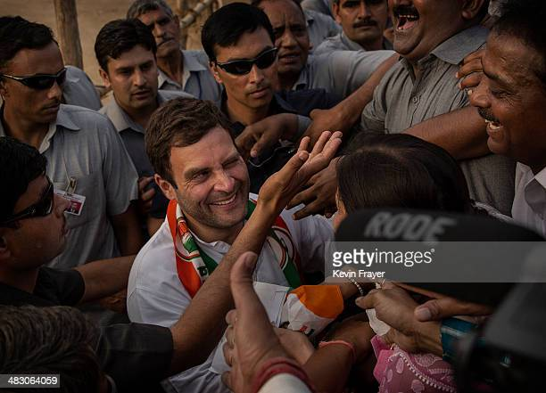 Rahul Gandhi leader of India's ruling Congress Party is embraced by a supporter at a rally on April 6 2014 in New Delhi India India will vote in a...