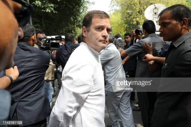 Rahul Gandhi president of the Congress Party center leaves a polling station after casting his ballot during the sixth phase of voting for national...