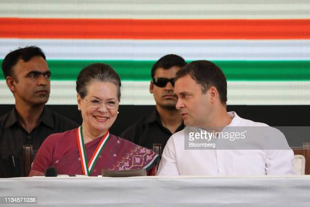 Rahul Gandhi, president of the Congress Party, right, speaks to his mother Sonia Gandhi, chair of the United Progressive Alliance, during an event...