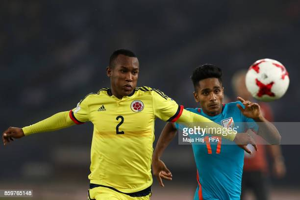 Rahul Kannoly of India and Andres Cifuentes of Colombia battle for the ball during the FIFA U17 World Cup India 2017 group A match between India and...