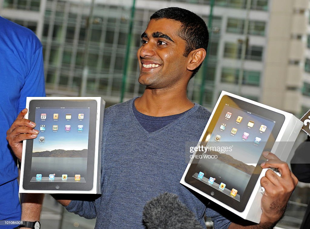 Rahul Koduri, who was first through the door, shows his two new iPad's bought at Apple's flagship store in Sydney on May 28, 2010. The iPad -- a buttonless tablet computer targeted at the leisure market -- is also going on sale in Japan, Britain, Canada, France, Germany, Italy, Japan, Spain and Switzerland on May 28 as part of a staggered global roll-out. AFP PHOTO / Greg WOOD