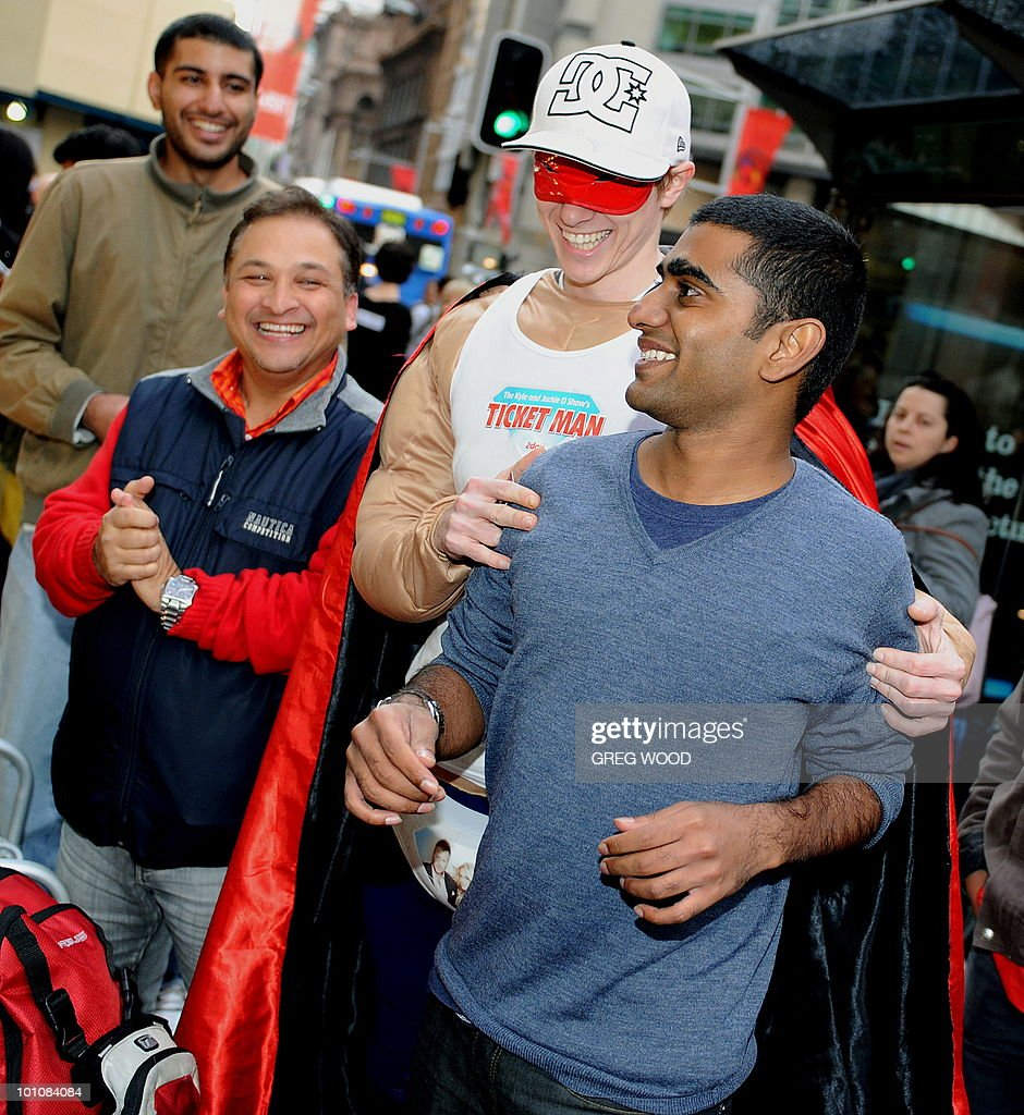 Rahul Koduri (R), who was first to line-up, reacts with other Sydney residents who queued ouside Apple's flagship store in Sydney on May 28, 2010 prior to the much-hyped iPad going on sale. The iPad -- a buttonless tablet computer targeted at the leisure market -- is also going on sale in Japan, Britain, Canada, France, Germany, Italy, Japan, Spain and Switzerland on May 28 as part of a staggered global roll-out. AFP PHOTO / Greg WOOD