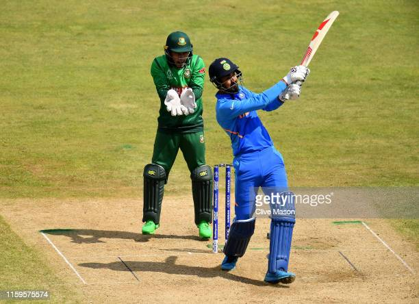 Rahul of India in action batting as Mushfiqur Rahim of Bangladesh looks on during the Group Stage match of the ICC Cricket World Cup 2019 between...