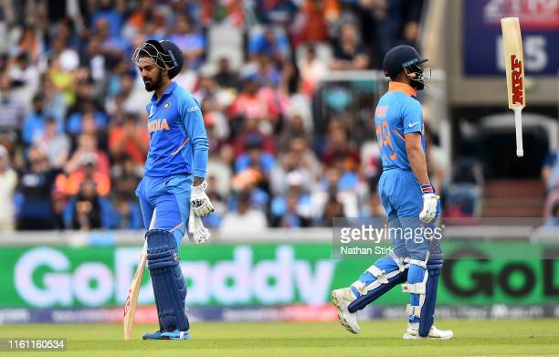Rahul of India looks on as team mate Virat Kohli walks after being dismissed lbw by Trent Boult of New Zealand during resumption of the Semi-Final...