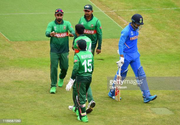 Rahul of India walks off after being dismissed by Rubel Hossain of Bangladesh during the Group Stage match of the ICC Cricket World Cup 2019 between...