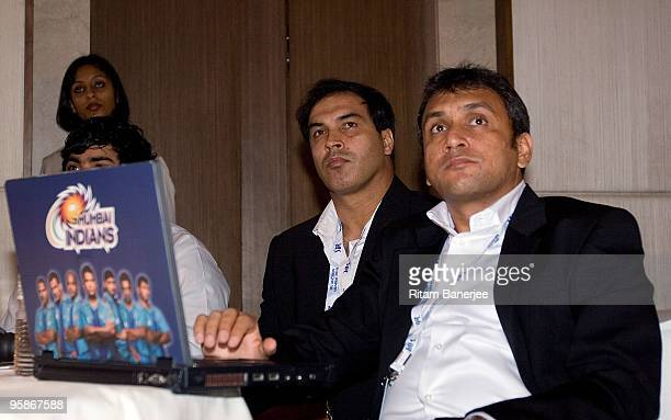 Rahul Sanghvi and Robin Singh of the Mumbai Indians team watch proceedings at the Indian Premier League Auction 2010 on January 19 2010 in Mumbai...