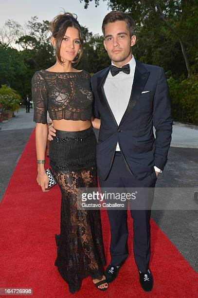 Raica Oliveira and Orazio Rispo attend the II BrazilFoundation Gala Miami at Vizcaya Museum Gardens on March 26 2013 in Miami Florida