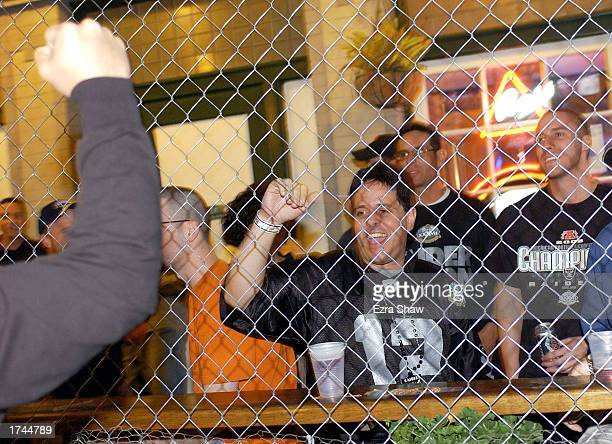 Raider fans cheer as other fans walk by the chained in area of the Blarney Stone Pub in the Gaslamp District on January 24 2003 in San Diego...