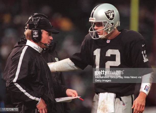 Raiders backup QB Donald Hollas right looks to head coach Jon Gruden for direction late in the fourth quarter against the Redskins The Raiders were...