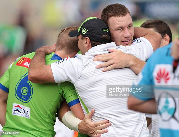 Raiders coach Ricky Stewart celebrates with Lachlan Croker and Shannon Boyd after the Raiders won the round two NRL match between the Canberra...