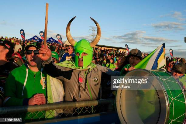 Raiders fan bangs his drum during the round eight NRL match between the Canberra Raiders and the Penrith Panthers at McDonalds Park on May 04, 2019...