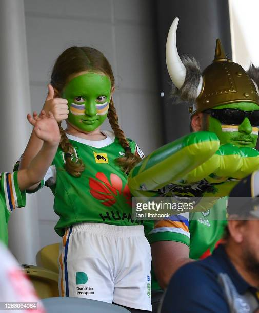 Raiders fan shows her support before the start during the round 12 NRL match between the North Queensland Cowboys and the Canberra Raiders at QCB...