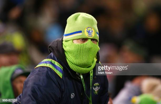 Raiders fan watches on during the round 18 NRL match between the Canberra Raiders and the North Queensland Cowboys at GIO Stadium on July 14 2018 in...