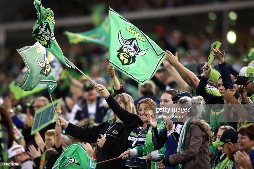 Raiders fans celebrate a try during the round seven NRL match between the Canberra Raiders and the New Zealand Warriors at GIO Stadium on April 15, 2017 in Canberra, Australia.