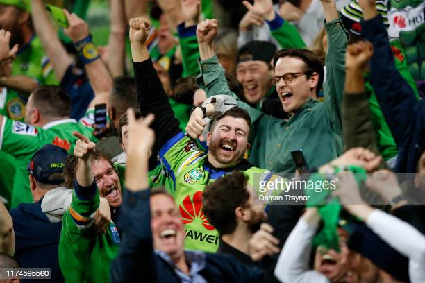 Raiders fans celebrate after a score review during the NRL Qualifying Final match between the Melbourne Storm and the Canberra Raiders at AAMI Park...