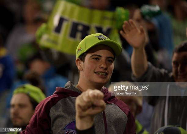 Raiders fans celebrate their win after the Round 5 Canberra Raiders and Parramatta Eels match at GIO Stadium on April 14 2019 in Canberra Australia