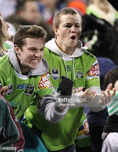 Raiders fans cheer their team on during the round 17 NRL match between the Canberra Raiders and the St George Dragons at Canberra Stadium on July 2...