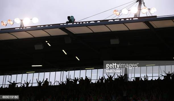 Raiders fans perform the Viking clap before the round three NRL match between the Canberra Raiders and the Wests Tigers at GIO Stadium on March 19...
