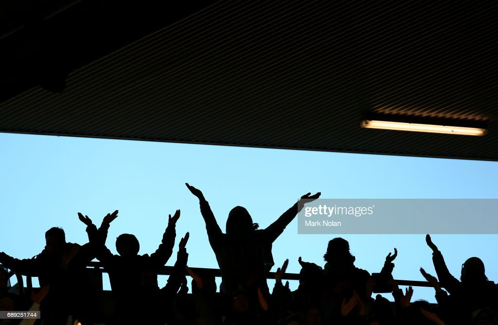 Raiders fans perform the Viking clap during the round 12 NRL match between the Canberra Raiders and the Sydney Roostrers at GIO Stadium on May 28, 2017 in Canberra, Australia.