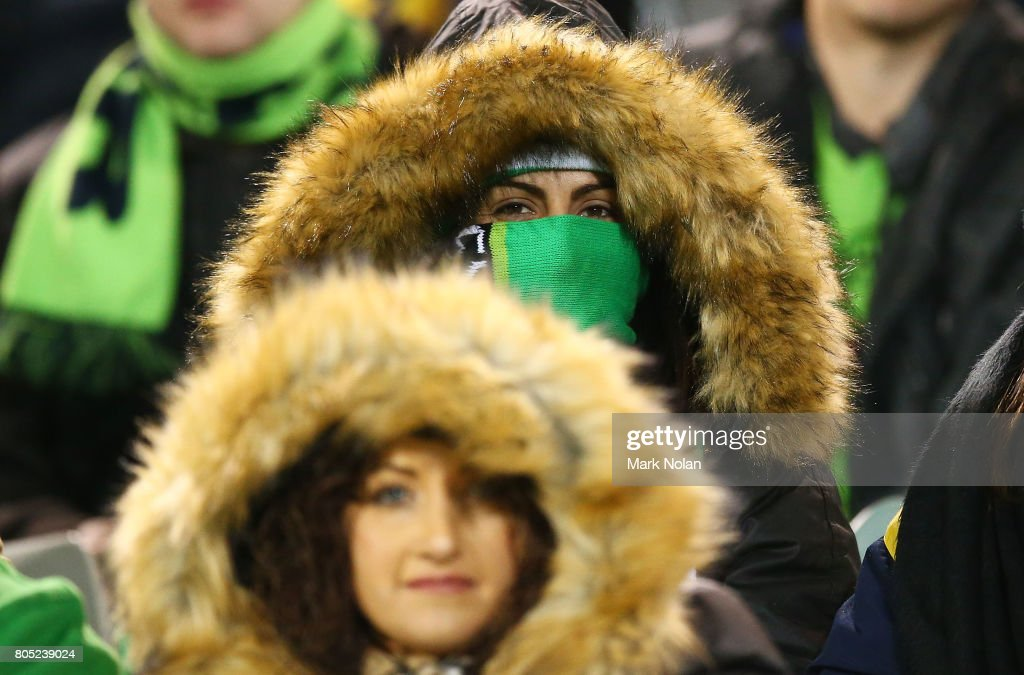 Raiders fans rug up in temperatures of -2 degrees during the round 17 NRL match between the Canberra Raiders and the North Queensland Cowboys at GIO Stadium on July 1, 2017 in Canberra, Australia.