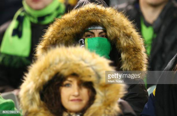 Raiders fans rug up in temperatures of -2 degrees during the round 17 NRL match between the Canberra Raiders and the North Queensland Cowboys at GIO...