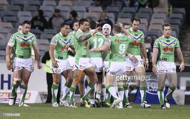 Raiders players celebrate after Blake Ferguson scored a try during the round 14 NRL match between the Canberra Raiders and the Penrtih Panthers at...