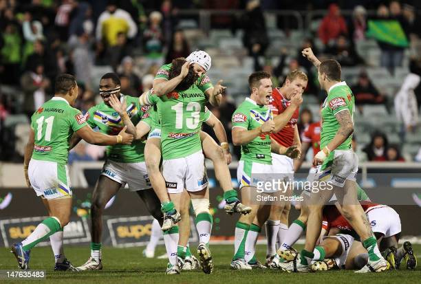 Raiders players celebrate after winning the round 17 NRL match between the Canberra Raiders and the St George Dragons at Canberra Stadium on July 2...