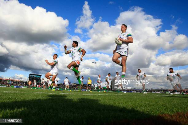 Raiders players warm up before the round eight NRL match between the Canberra Raiders and the Penrith Panthers at McDonalds Park on May 04 2019 in...