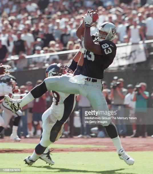 Raiders Rickey Dudley makes an 11yard catch for a TD in the third quarter over Denver defender Glenn Cadrez