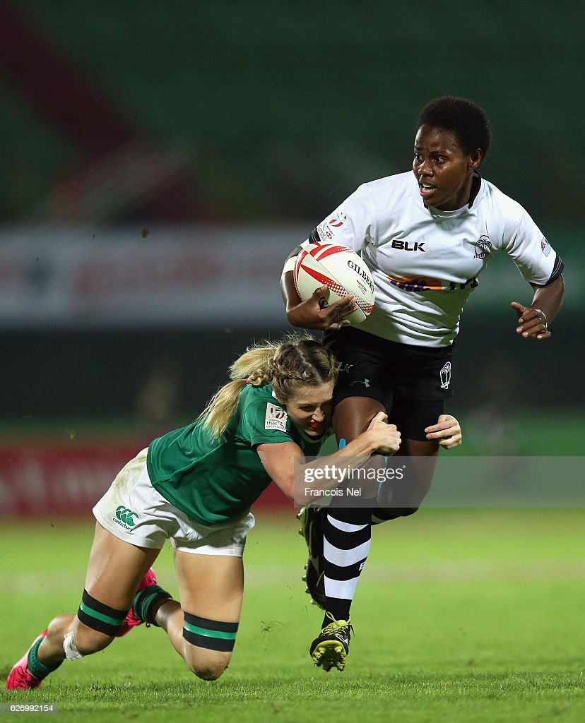 Raijieli Daveua of Fiji is tackled by Ashleigh Baxter of Ireland during day one of the Emirates Dubai Rugby Sevens - HSBC World Rugby Women's Sevens Series on December 1, 2016 in Dubai, United Arab Emirates.