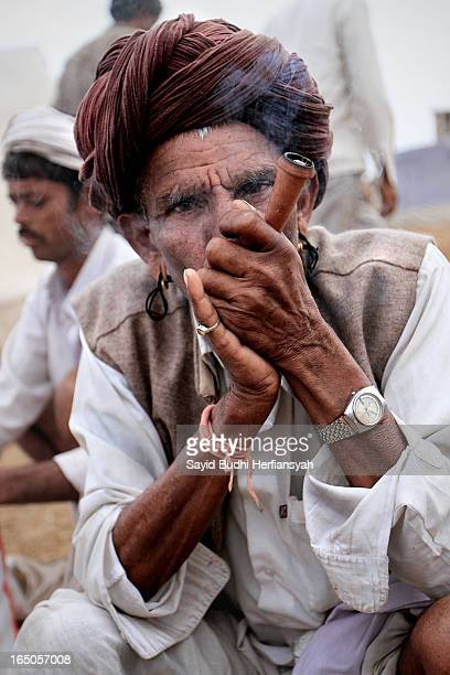 Raika men sit and smoke a chillum during the annual Pushkar Mela the biggest camel fair and livestock held in the town of Pushkar in the state of...