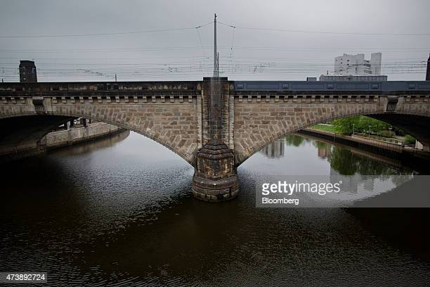 A rail bridge reaches over the Schuylkill River in Philadelphia Pennsylvania US on Saturday May 9 2015 Philadelphia the largest city in the...
