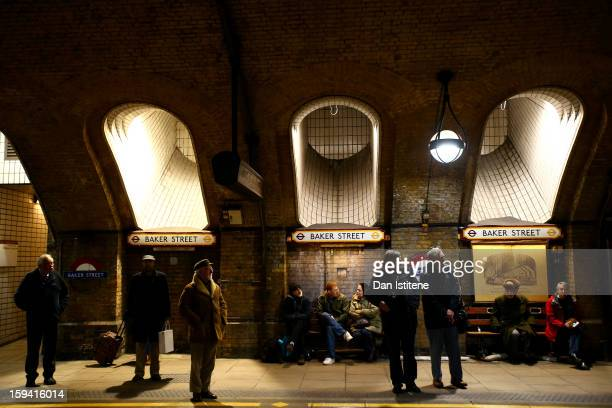 Rail enthusiasts wait on the platform to see the newly restored steam engine built in 1898 known as Met Locomotive No 1 arrive at Baker Street...